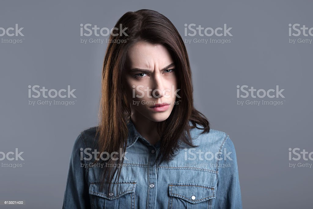 Choleric young woman stock photo