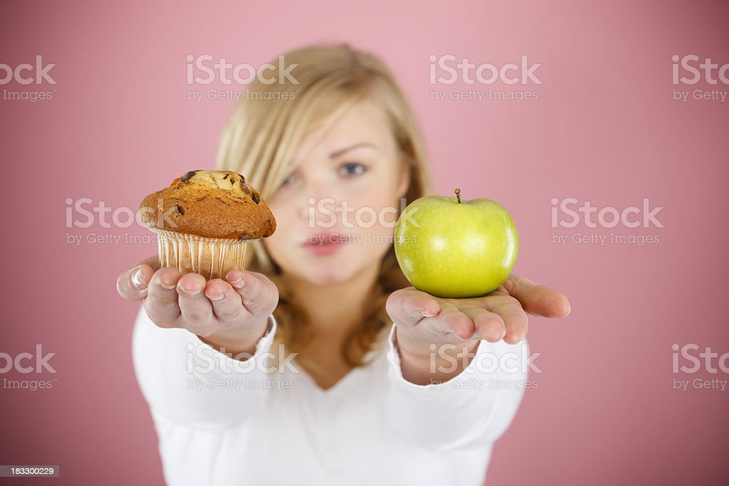 Choose between cake and apple stock photo