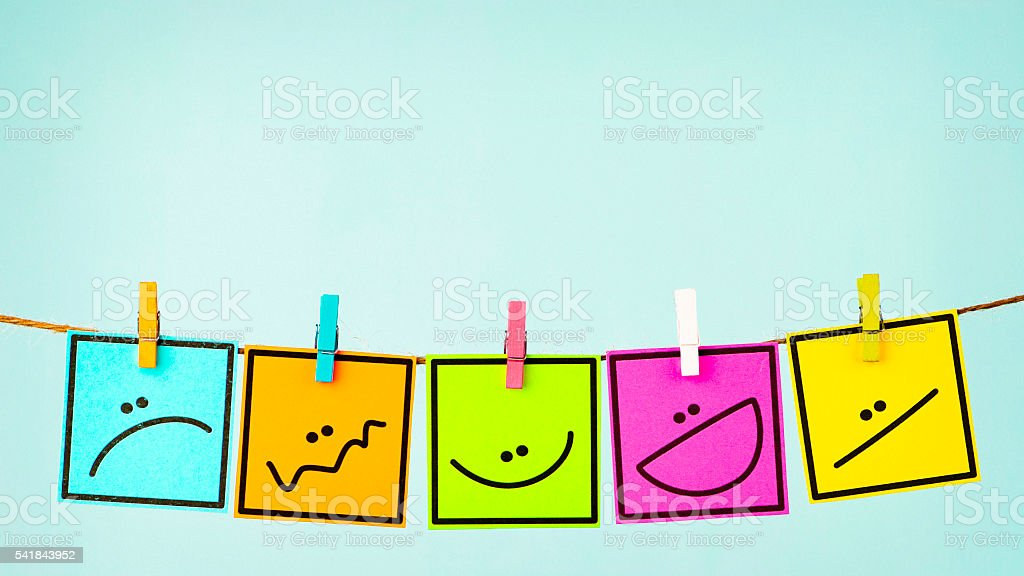 Choose your mood. Five different emotions on vibrant colored cards stock photo