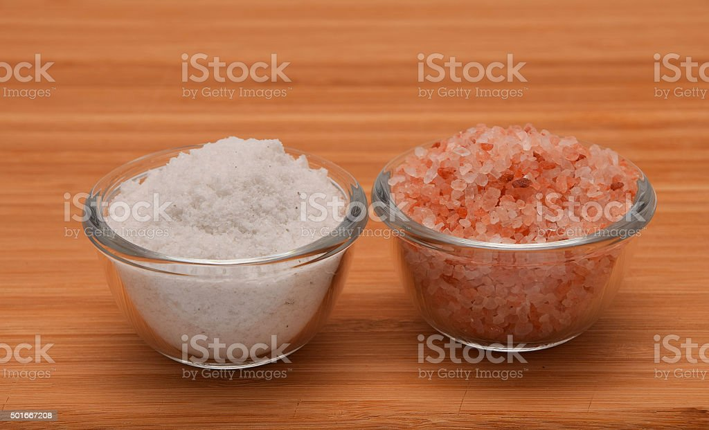 Choose your salt - Himalayan or rock salt on wood royalty-free stock photo