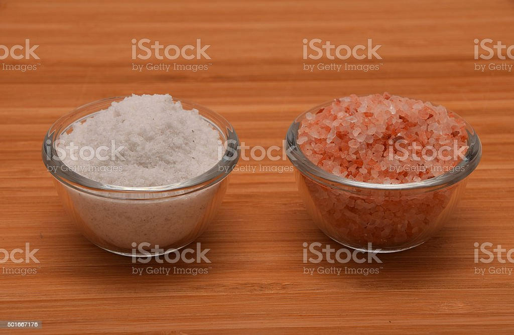 Choose your salt - Himalayan or rock salt (side view) royalty-free stock photo