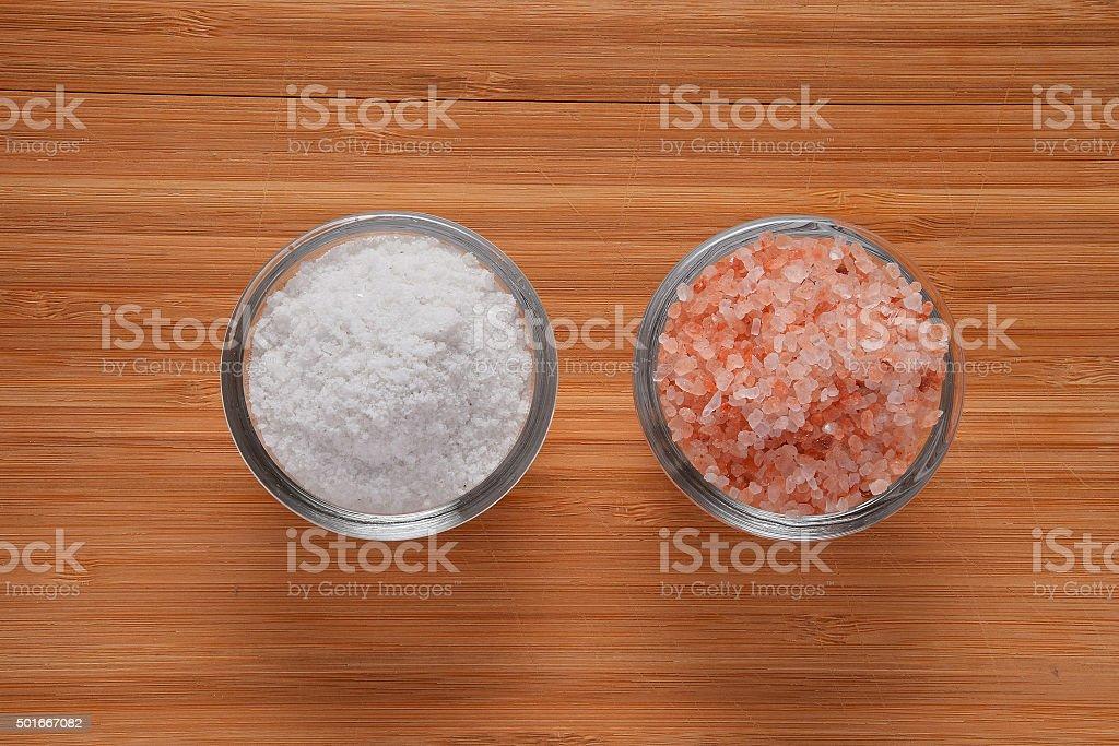 Choose your salt - Himalayan or rock salt top view royalty-free stock photo