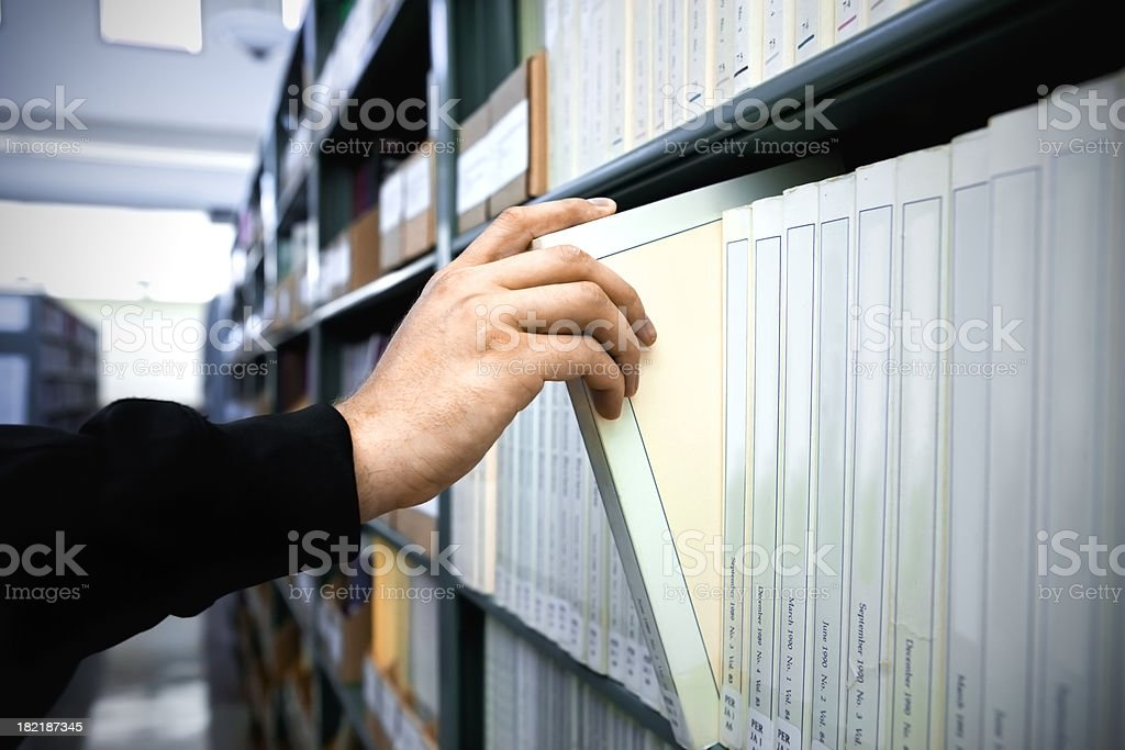 Choosing a book in the library royalty-free stock photo