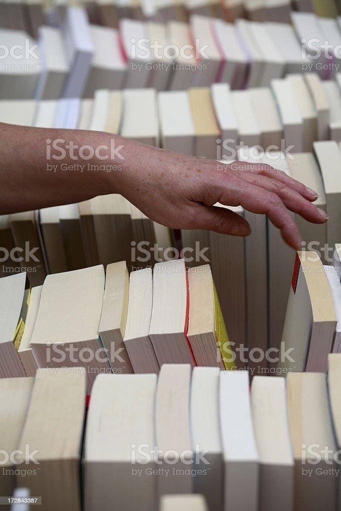 Choosing a book royalty-free stock photo