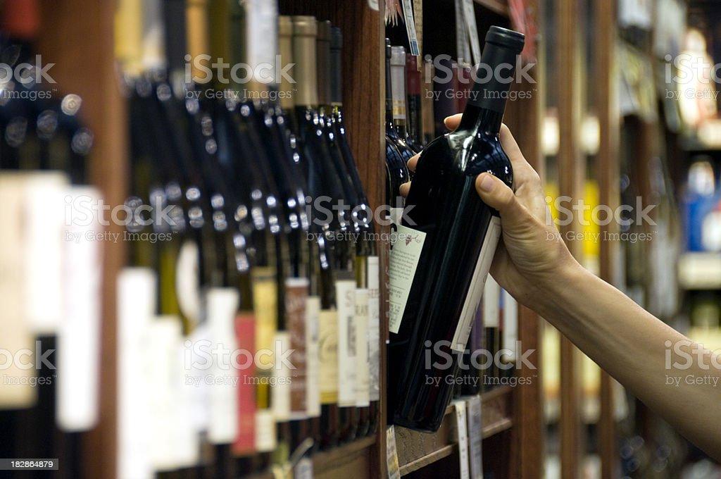 Choosing a Bottle of Wine royalty-free stock photo