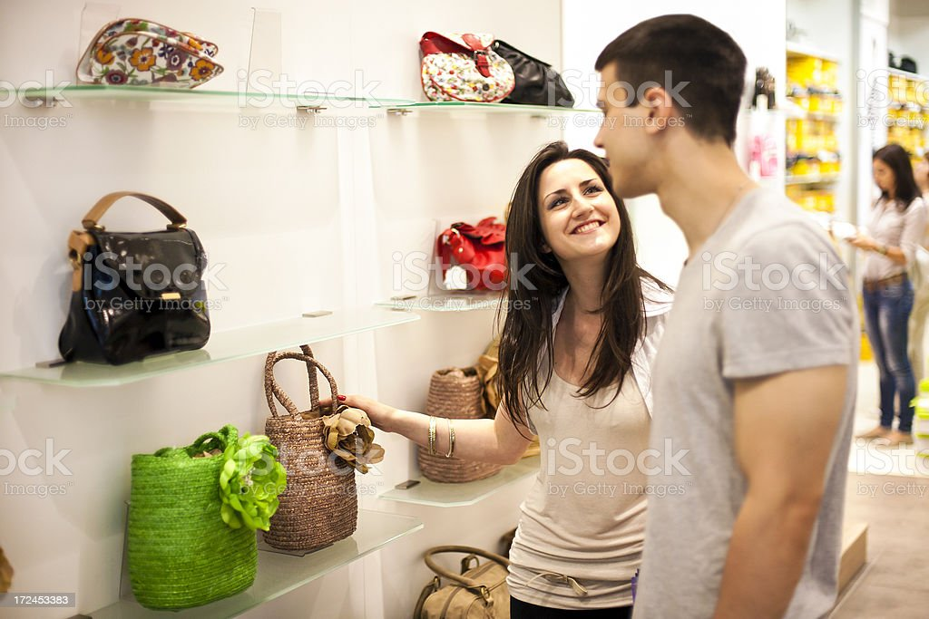 Choosing a purse in a store royalty-free stock photo