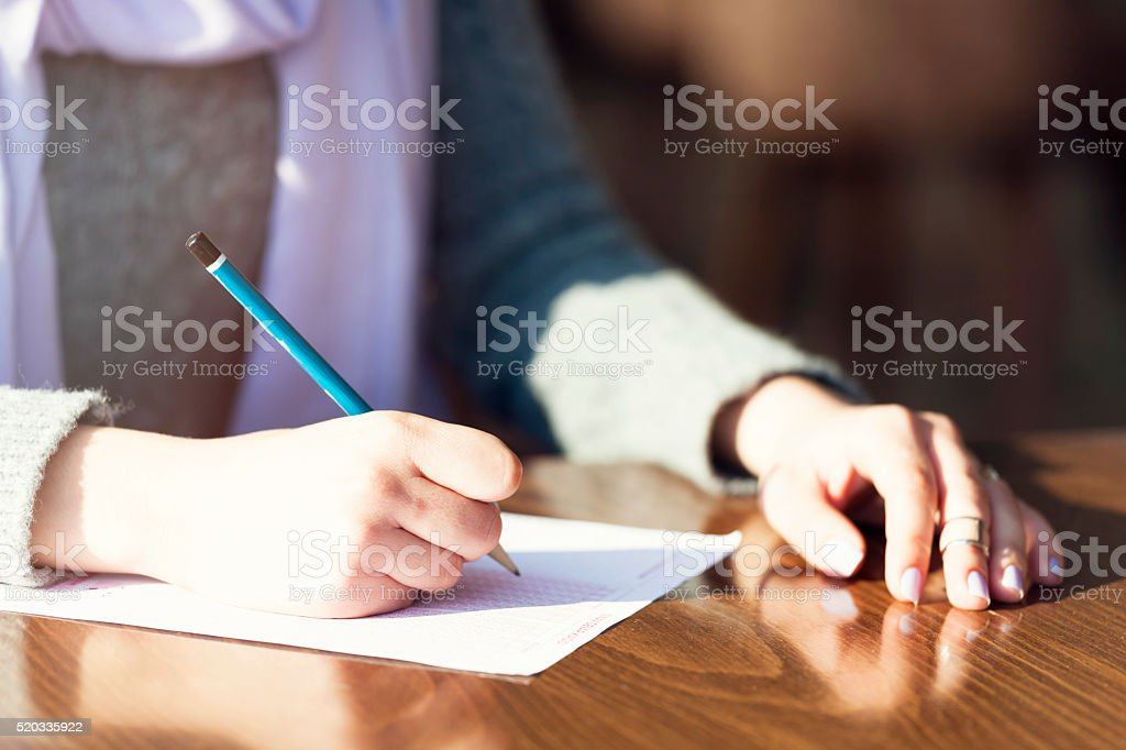 Choosing answer in the classroom stock photo