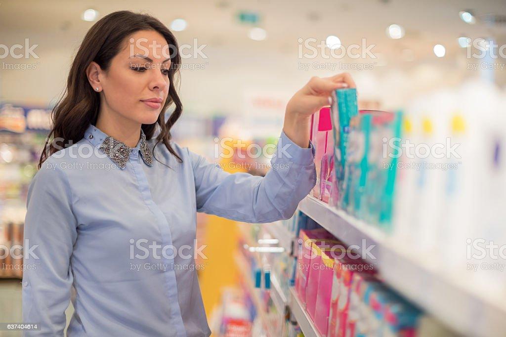 Choosing between tampons and sanitary pads stock photo