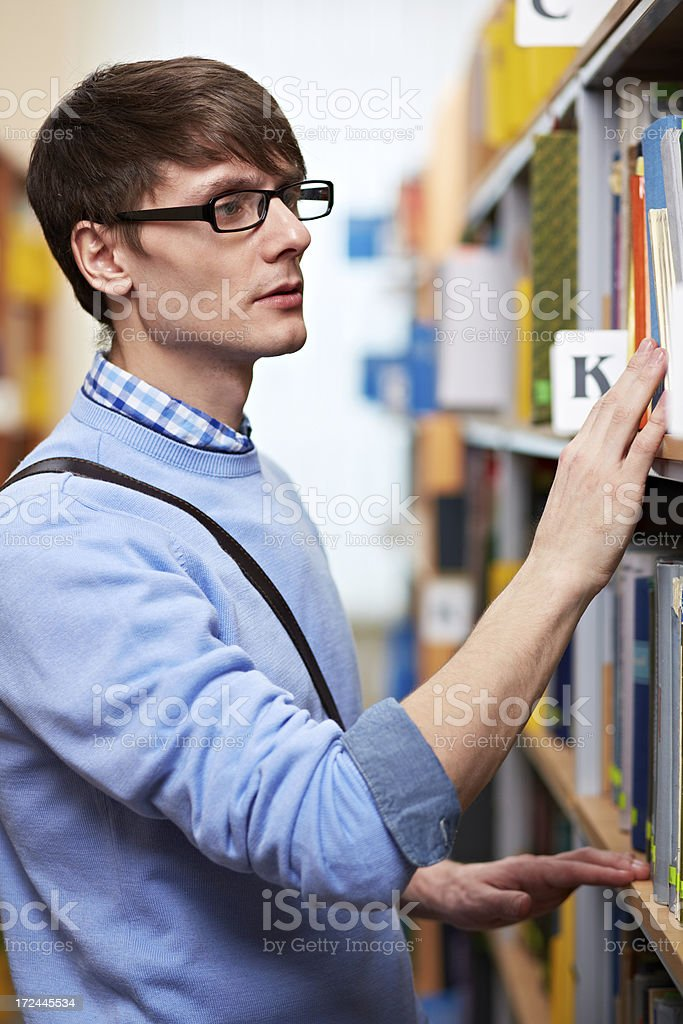 Choosing book at library royalty-free stock photo