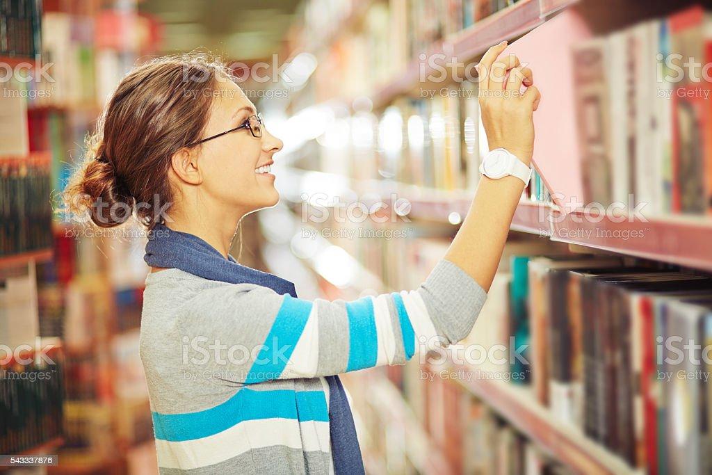Choosing book stock photo