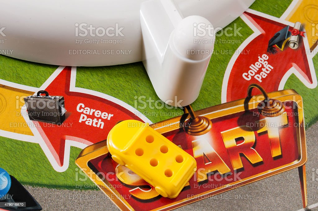 Choosing career over college in The Game of Life stock photo