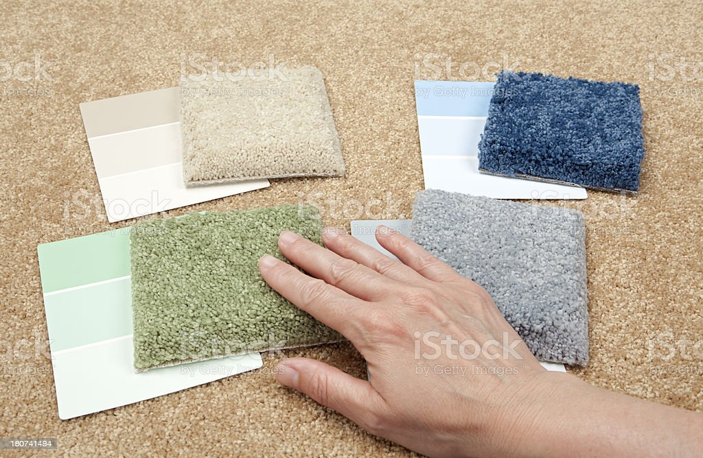 Choosing Carpet Samples and Color Swatches royalty-free stock photo