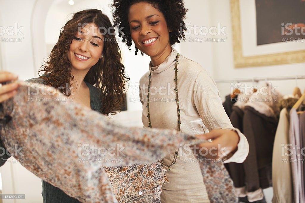Choosing clothes on a shop. royalty-free stock photo