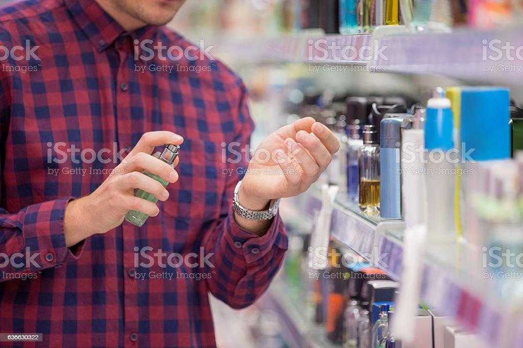 Choosing cosmetics in local supermarket stock photo