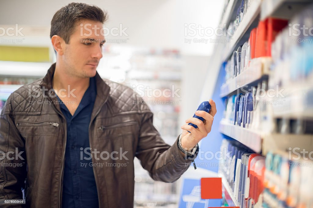 Choosing cosmetics in local supermarket stock photo