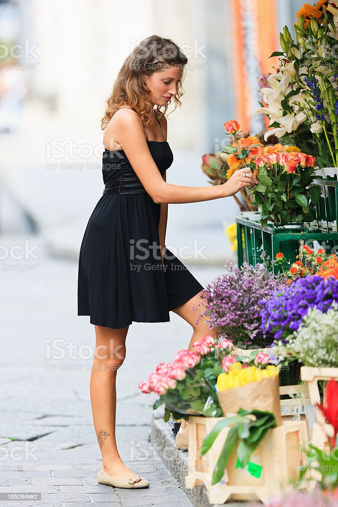 Choosing Flowers Young Woman Florist Summer Portrait stock photo