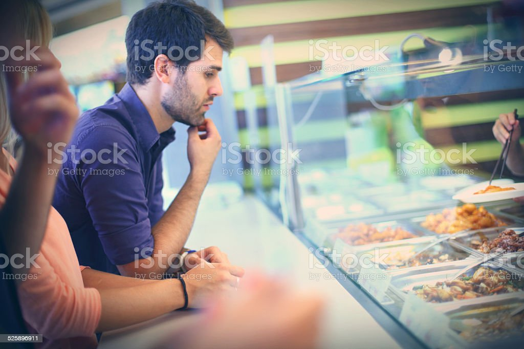 Choosing food in cafeteria. stock photo