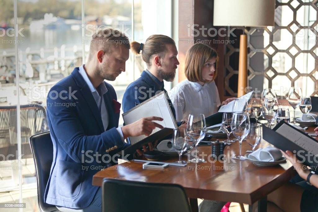 Choosing from menu stock photo
