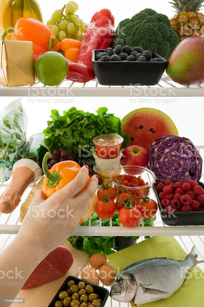 Choosing healthy food from the refrigerator royalty-free stock photo
