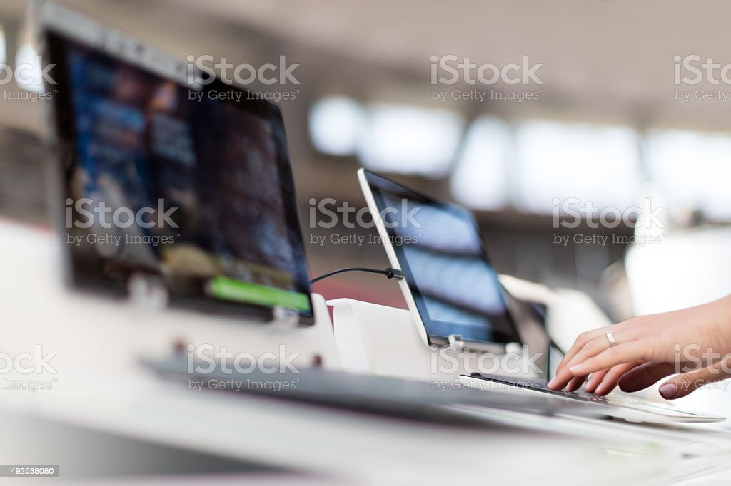 Choosing laptop stock photo