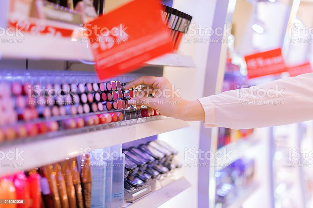 Choosing lipstick stock photo