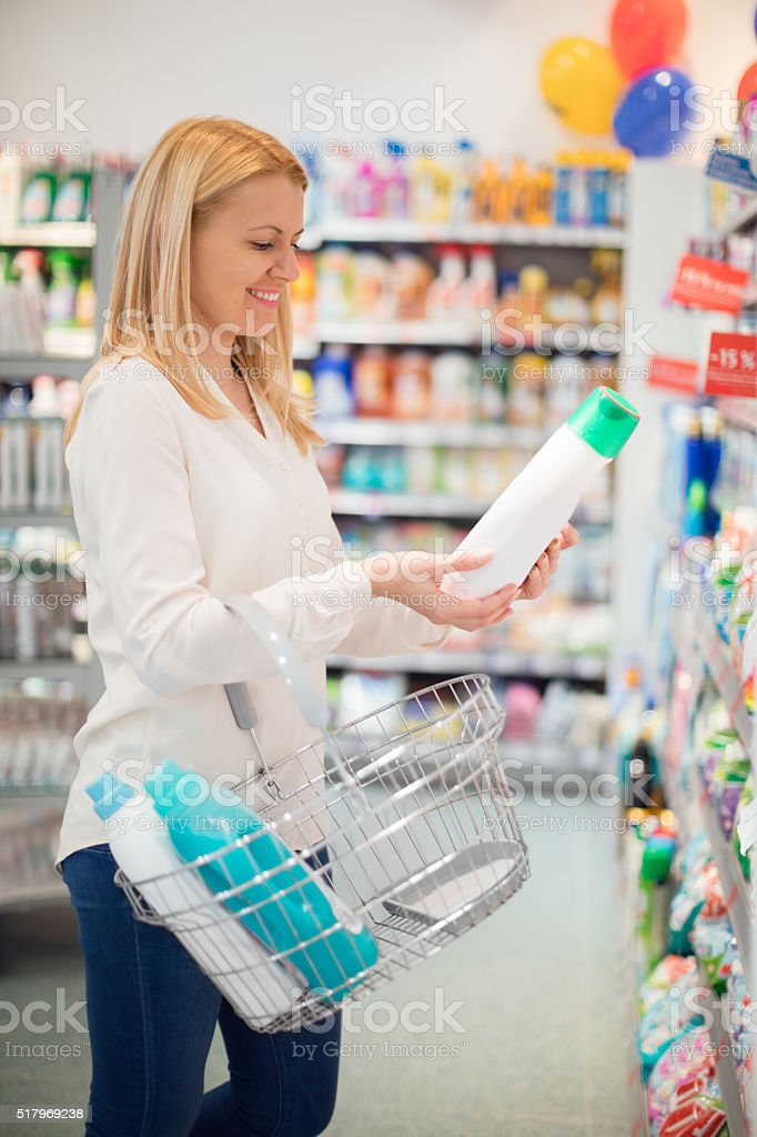 Choosing liquid detergent stock photo