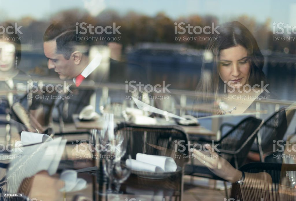 Choosing meal from menu stock photo