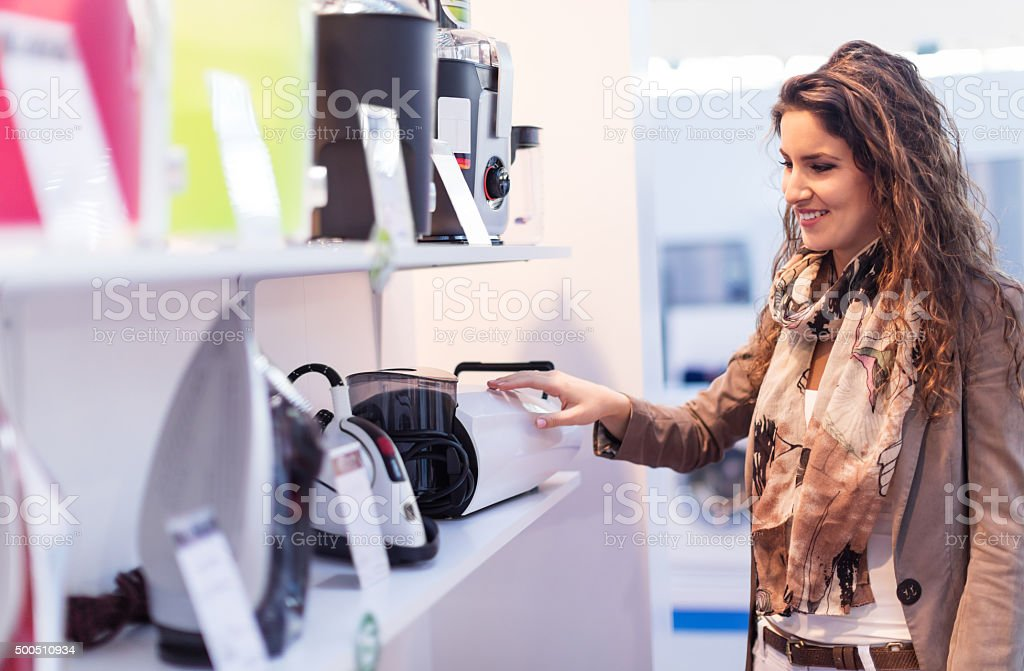 Choosing new vacuum cleaner stock photo