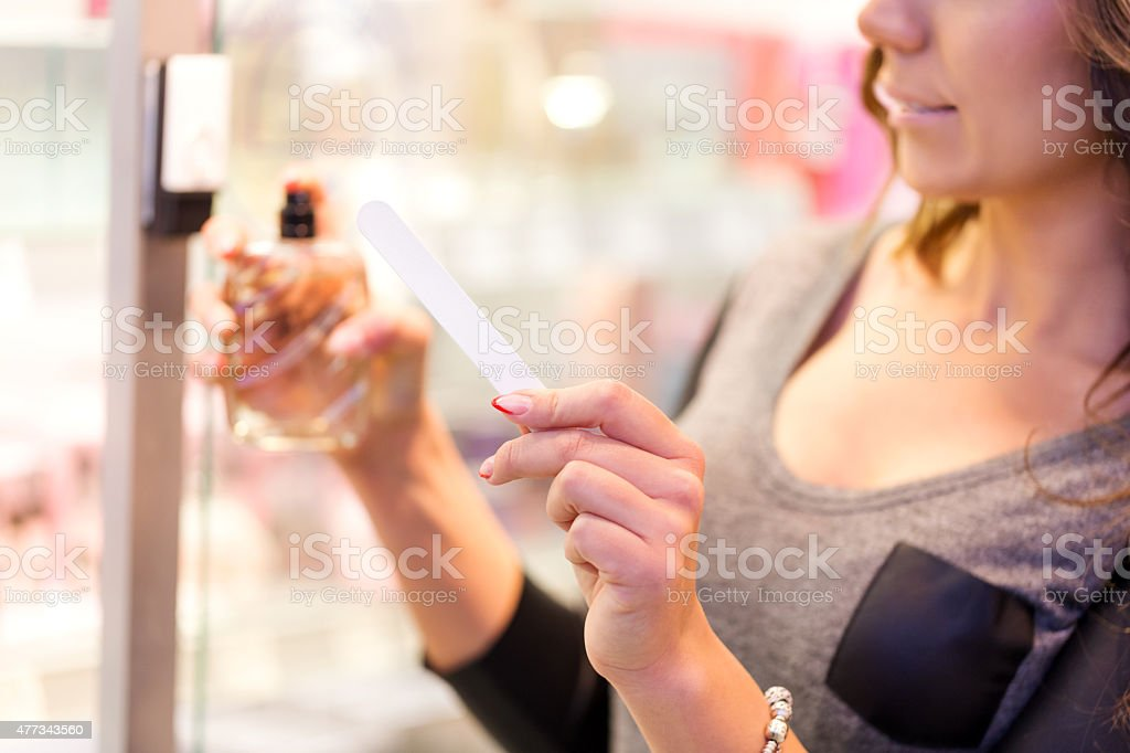 Choosing parfume in store stock photo
