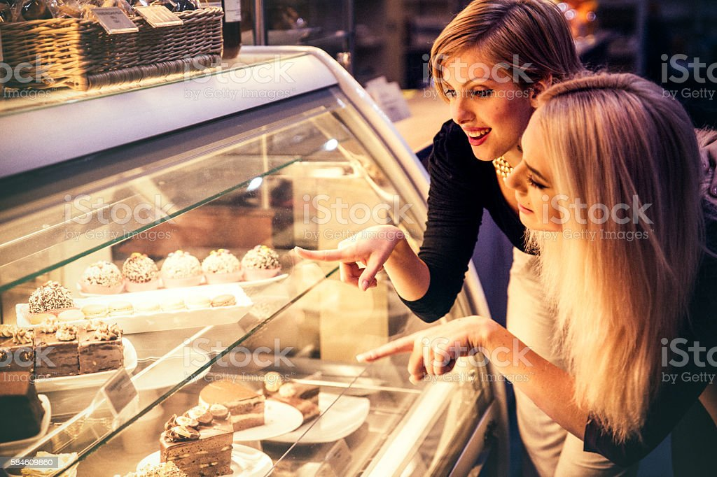 Choosing pastries in a cafe stock photo
