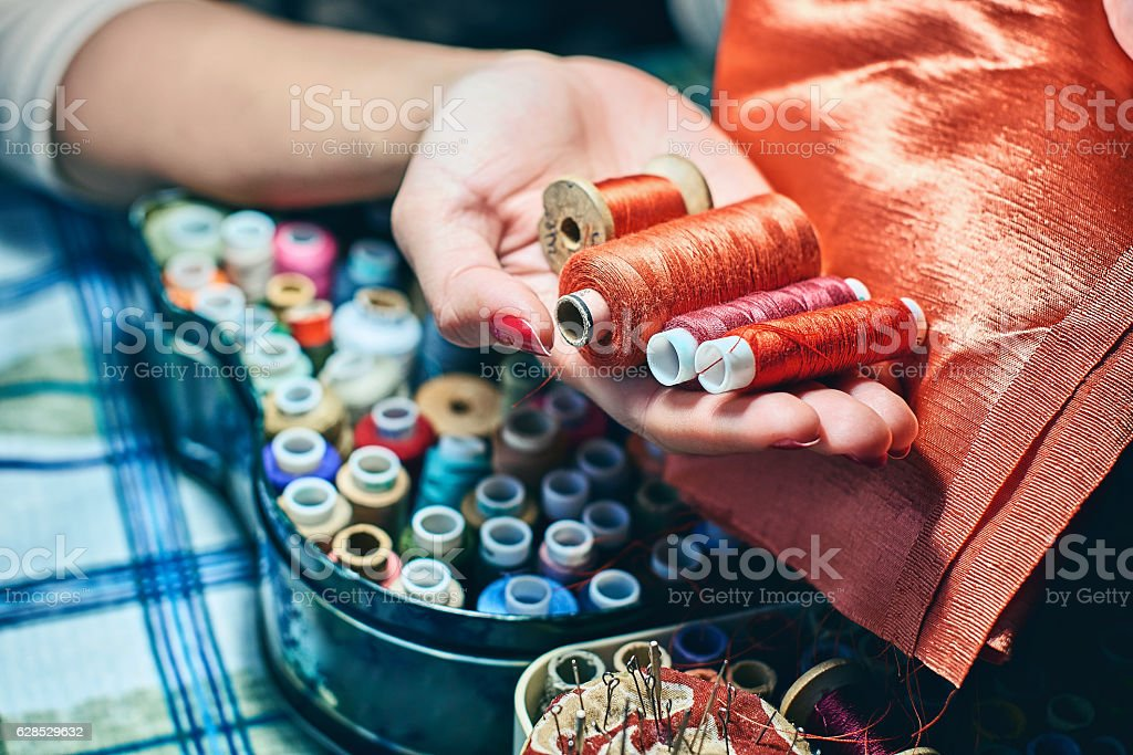 Choosing red color shade for needlework stock photo