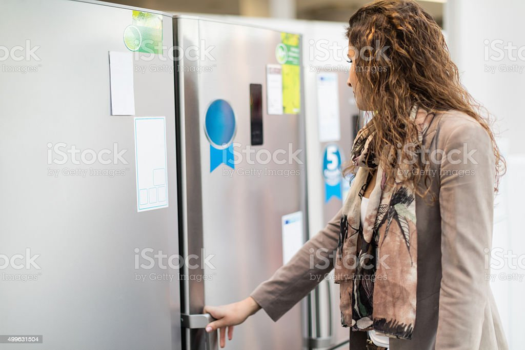 Choosing refrigerator in a store stock photo