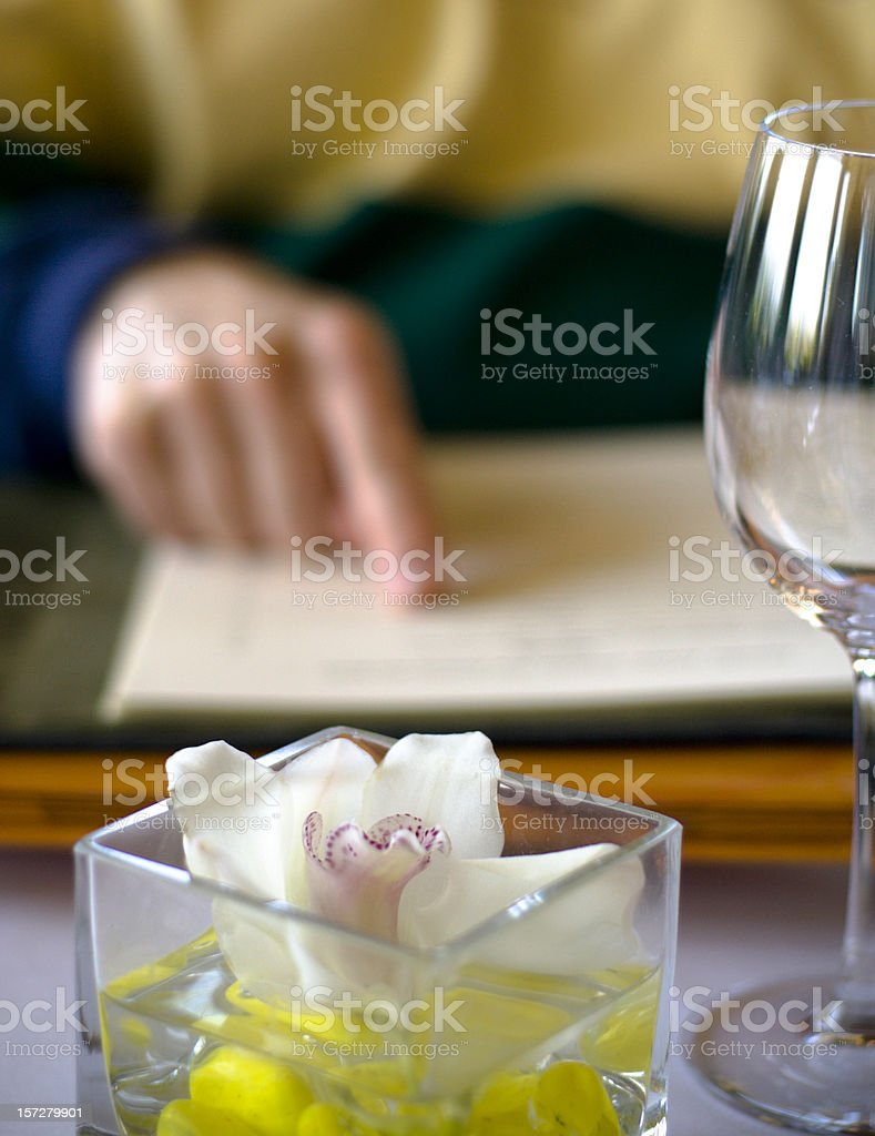 Choosing & Restaurant Lunch Menu, Examining Wine List for Bottle Ordering stock photo