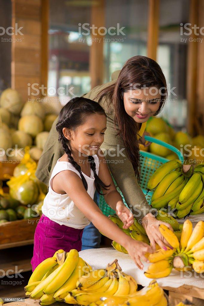 Choosing ripe bananas stock photo