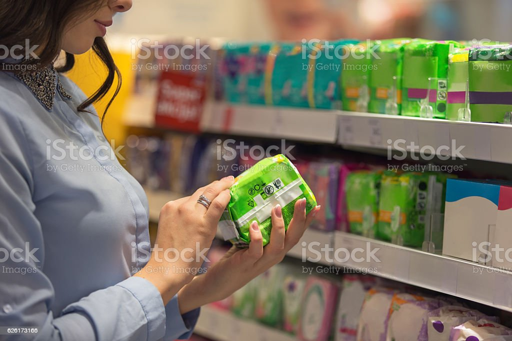 Choosing sanitary pad stock photo