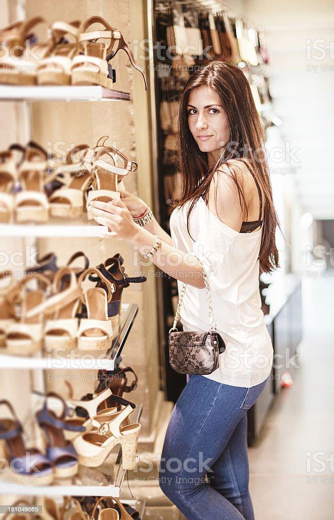choosing shoes at store royalty-free stock photo