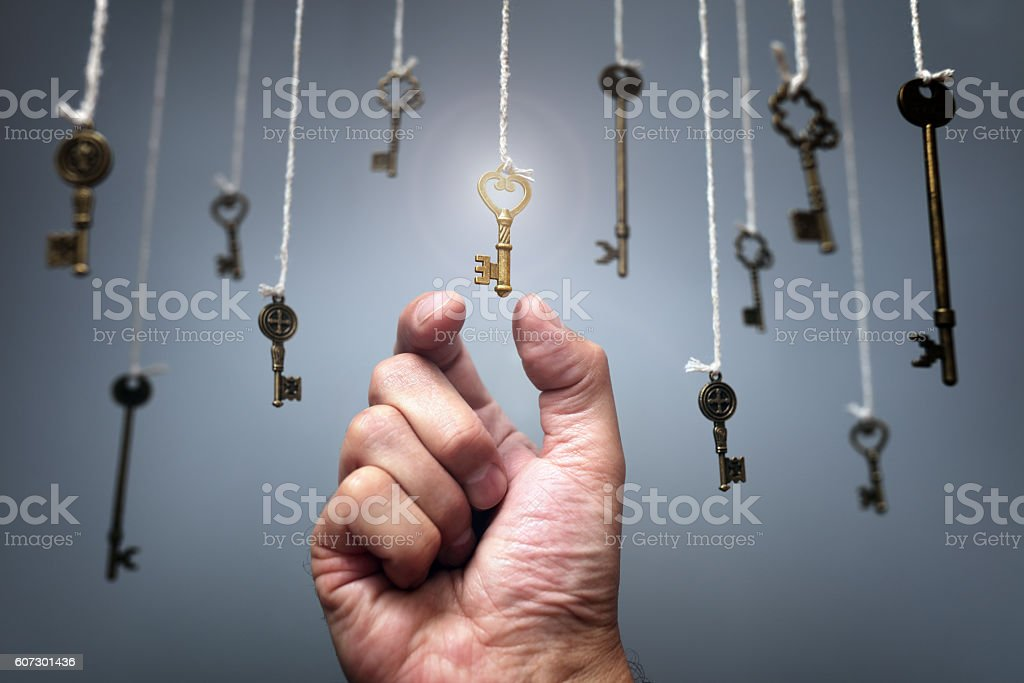 Choosing the key to success stock photo