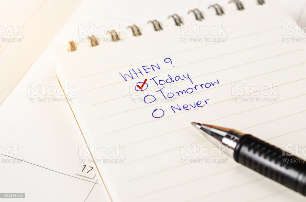 Choosing the right date on diary stock photo