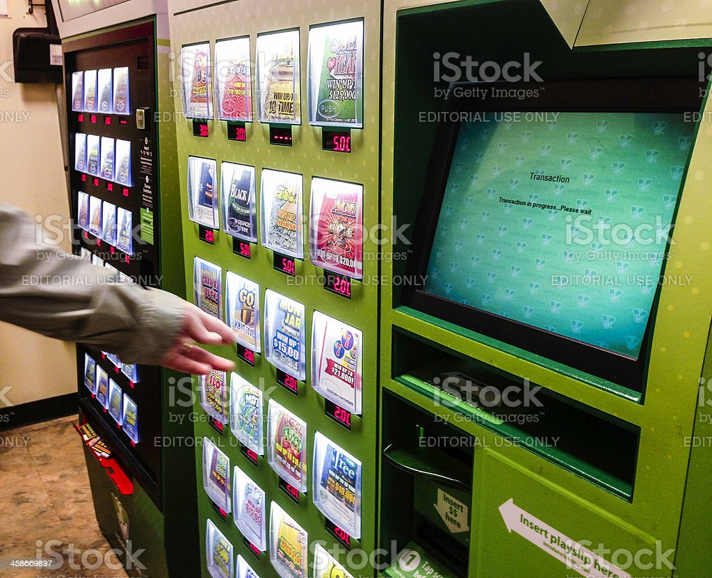 Choosing Tickets From a Lottery Vending Machine stock photo