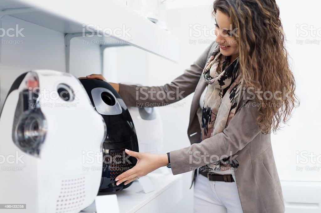Choosing vacuum cleaner stock photo