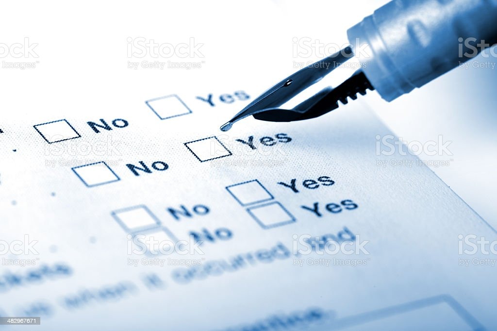 Choosing Yes on application form stock photo