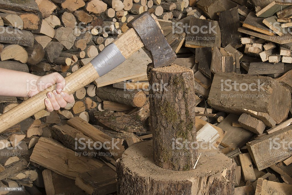 chop wood with axe and pile stock photo
