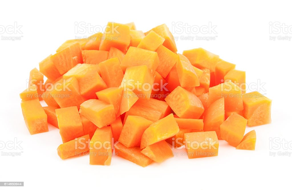 chopped and sliced carrot on white stock photo