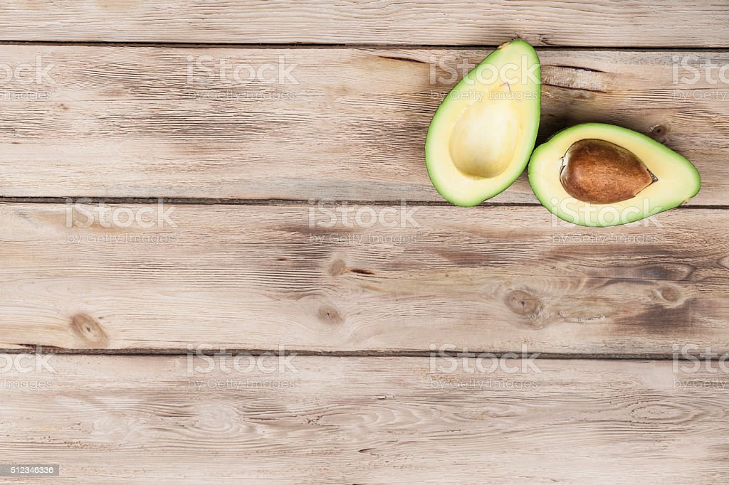 Chopped avocado on wooden table stock photo