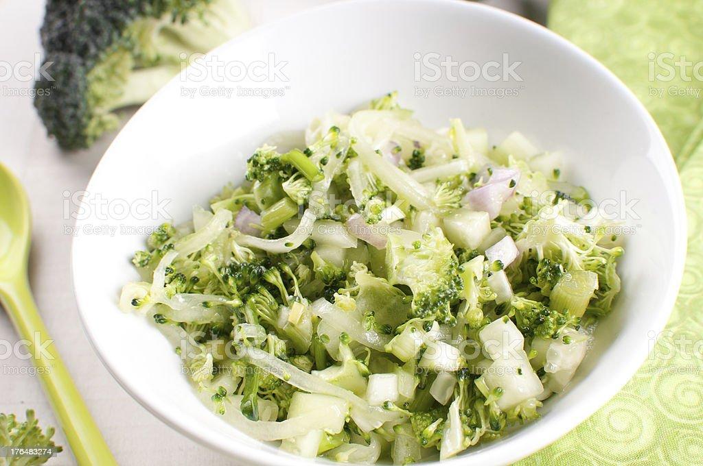 Chopped broccoli and cucumbers salad stock photo