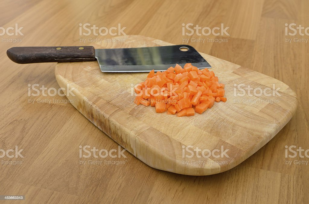 Chopped carrot and knife on the chopping block royalty-free stock photo
