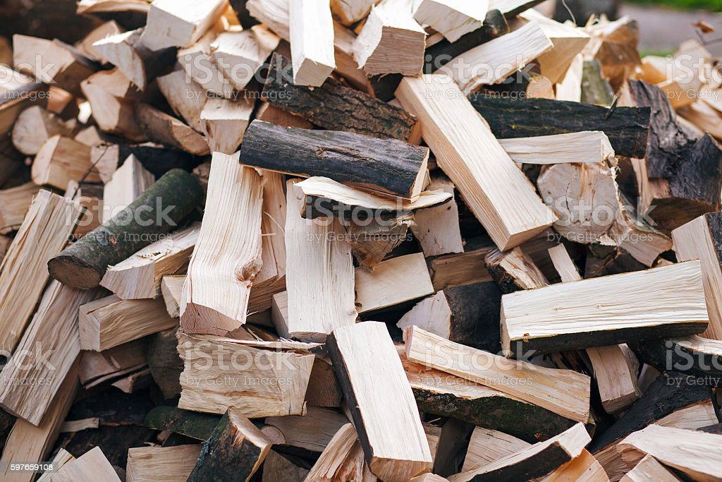 chopped firewoods on a stack stock photo
