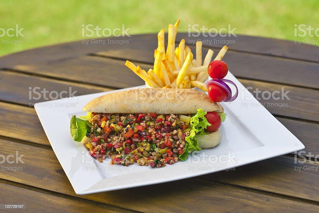Chopped fish sandwich royalty-free stock photo