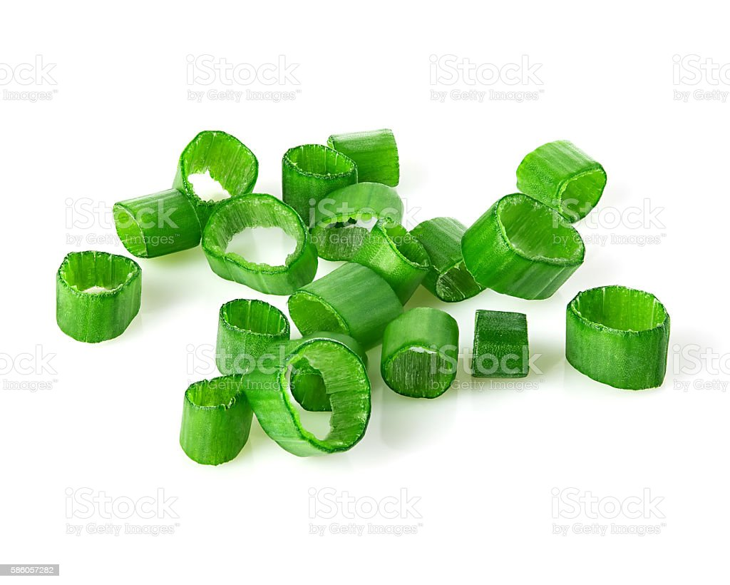 Chopped green onions close-up isolated on a white background. stock photo
