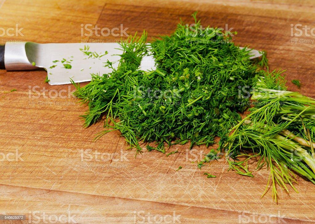 chopped herbs on cutting board stock photo